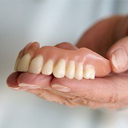 top dentures in hand
