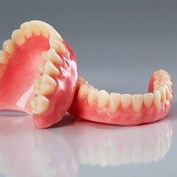 set of dentures on counter