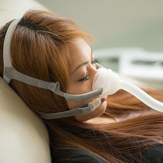woman with cpap machine