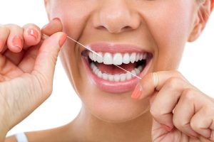 smiling woman flossing