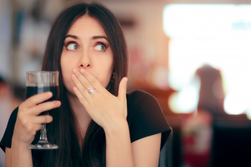 woman reacting after drinking wine